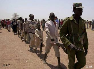 Child soldiers march behind an adult rebel from the SPLA after being demobilized