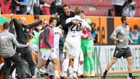 Augsburg celebrate a win that keeps them in the division