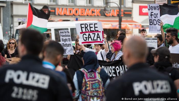 Pro-Palestinian demonstrators protesting against Israel's actions at the border with the Gaza strip on the Hermannplatz square in Berlin's Neukoelln district