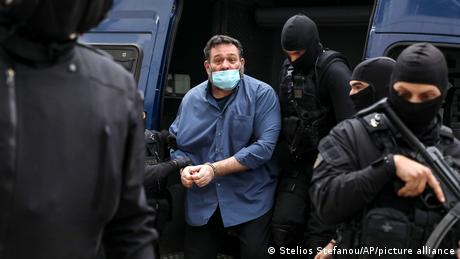 Far-right MEP Ioannis Lagos with armed Greek police