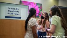 Three women wearing masks