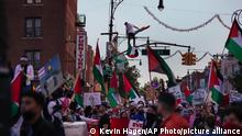 Thousands of activists supporting Palestine march during a rally Saturday, May 15, 2021, in New York. The rally supports Palestine in the ongoing conflict between Israel and Palestine on the day Israeli airstrikes leveled several buildings in the Gaza strip. (AP Photo/Kevin Hagen)