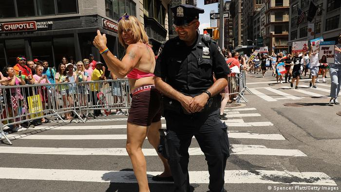 A police officer dances during the New York Pride Parade