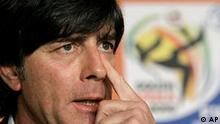 Germany head coach Joachim Loew wipes his nose during a news conference of the German national soccer team in Cape Town, South Africa, Friday, July 2, 2010. Germany will play against Argentina in the quarterfinal of the soccer World Cup in Cape Town, Saturday, July 3, 2010. (AP Photo/Gero Breloer)