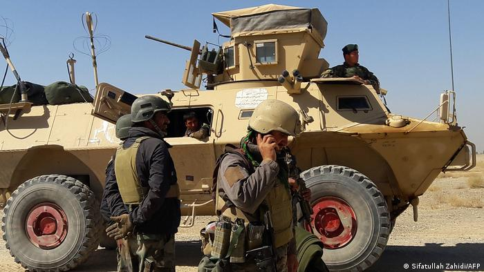 Afghan security forces with tank