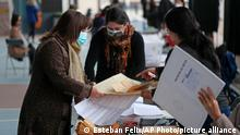 Women cast ballots in Chile's election