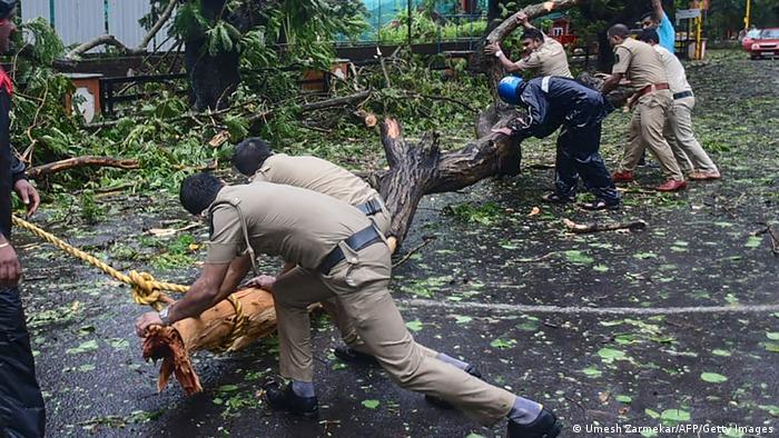 Police clear a fallen tree