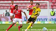 MAINZ, GERMANY - MAY 16: Marco Reus of Borussia Dortmund is challenged by Leandro Barreiro of 1.FSV Mainz 05 during the Bundesliga match between 1. FSV Mainz 05 and Borussia Dortmund at Opel Arena on May 16, 2021 in Mainz, Germany. Sporting stadiums around Germany remain under strict restrictions due to the Coronavirus Pandemic as Government social distancing laws prohibit fans inside venues resulting in games being played behind closed doors. (Photo by Sascha Steinbach - Pool/Getty Images)
