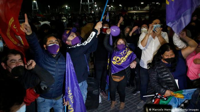 People cheer in Santiago's streets