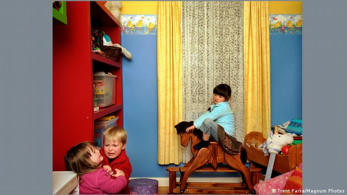 Trent Parke's photograph showing three children in a nursery.