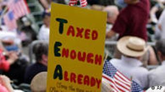 Post at a Tea Party rally. TEA: Taxed Enough Already