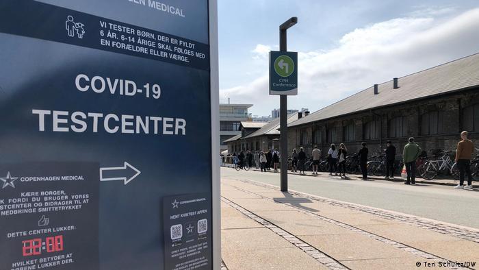 People stand in line at a Copenhagen coronavirus test center