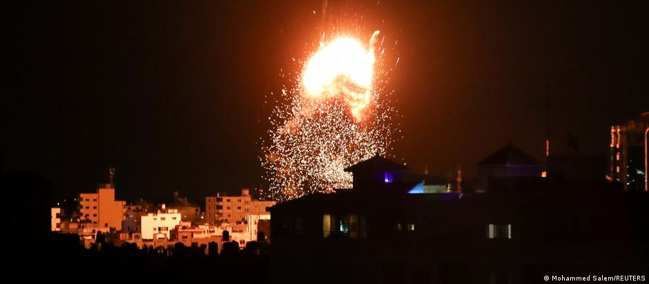 Smoke and flames rise above a building during Israeli air strikes
