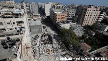 May 16, 2021*** Rescuers search for people in the rubble of a building at the site of Israeli air strikes, in Gaza City May 16, 2021. REUTERS/Mohammed Salem SEARCH SUZY ESHKUNTANA FOR THIS STORY. SEARCH WIDER IMAGE FOR ALL STORIES.
