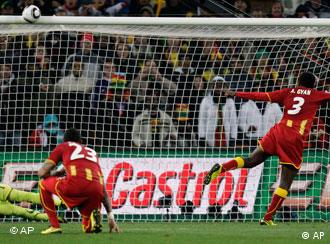 Ghana's Asamoah Gyan, right, misses on a penalty shot as Uruguay goalkeeper Fernando Muslera, bottom left, looks up during the World Cup quarterfinal soccer match between Uruguay and Ghana at Soccer City in Johannesburg, South Africa, Friday, July 2, 2010. (AP Photo/Luca Bruno)