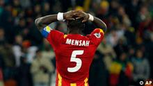 Ghana's John Mensah reacts after missing a shootout penalty during the World Cup quarterfinal soccer match between Uruguay and Ghana at Soccer City in Johannesburg, South Africa, Friday, July 2, 2010. Uruguay reached the World Cup semifinals for the first time since 1970, beating Ghana 4-2 on penalties after a 1-1 draw Friday. (AP Photo/Bernat Armangue)