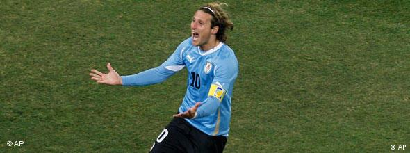 Uruguay's Diego Forlan celebrates after scoring a goal during the World Cup quarterfinal soccer match between Uruguay and Ghana at Soccer City in Johannesburg, South Africa, Friday, July 2, 2010.
