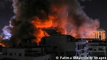 GAZA CITY, GAZA - MAY 18: Fire and smoke rise above buildings in Gaza City as Israeli warplanes target a governmental building, early on May 18, 2021 in Gaza City, Gaza. More than 200 people in Gaza and ten people in Israel have been killed as cross-border rocket exchanges intensified. Israel has vowed to continue the bombing campaign despite increasing calls from the United Nations and the international community to end the conflict. The conflict which erupted May 10, comes after weeks of rising Israeli-Palestinian tension in East Jerusalem, which peaked with violent clashes inside the holy site of Al-Aqsa Mosque. (Photo by Fatima Shbair/Getty Images)