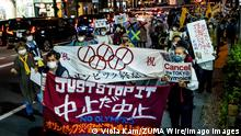 May 17, 2021, Tokyo, Japan: Protesters hold banners and placards expressing their opinions during the demonstration..Demonstrators protest against the Tokyo Olympics with billboards and banners shouting Just stop it marching through the Shimbashi and Ginza area. Tokyo Japan - ZUMAs197 20210517_zaa_s197_030 Copyright: xViolaxKamx - ZUMA1182 0118219634st Copyright: xViolaxKamxviaxwww.imago-images.dex