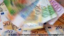 EURO, Schweizer Franken und Dollar