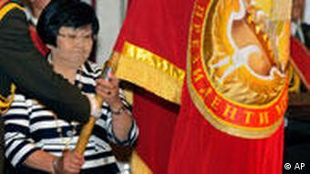 Otunbayeva symbolically holds the Standard of the President of Kyrgyzstan