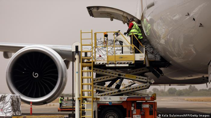 The first batch of Oxford/AstraZenica COVID-19 vaccine doses are offloaded from a plane during its arrival in Abuja, Nigeria