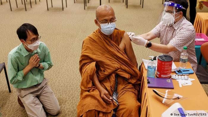 A monk receives his COVID shot in Bangkok, Thailand