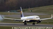Coronavirus - Mon May 17, 2021. File photo dated 11/03/20 of a Boeing 737-8AS (SP-RSG) owned and operated by Ryanair landing at Birmingham Airport. Holidaymakers risk losing out due to confusion over the extent to which coronavirus-related disruption is included in travel insurance policies, Which? is warning. Issue date: Monday May 17, 2021. Its research suggests many travel insurance customers are being left with a false impression about their level of protection if the pandemic affected their holiday plans. See PA story TRANSPORT Coronavirus Insurance. Photo credit should read: Steve Parsons/PA Wire URN:59829026 zu dpa: Ryanair-Teilerfolg im Kampf gegen Corona-Hilfen für Konkurrenz
