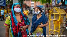 May 18, 2021, New Delhi, India: Women mourning the death of a family member outside the Lok Nayak Hospital..India recorded 4329 death in the last 24 hours. The highest in one day of covid-19 death. (Credit Image: © Pradeep Gaur/SOPA Images via ZUMA Wire