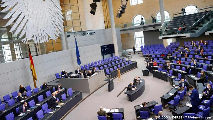 German Bundestag interior, blue seats in a large auditorium.
