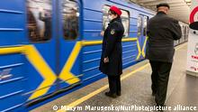 An employee of the Kyiv subway in a mask on his face because of the danger of the spread of coronavirus. Kyiv, Ukraine. February 27, 2020 (Photo by Maxym Marusenko/NurPhoto)