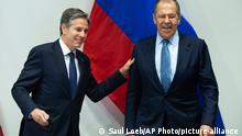 U.S. Secretary of State Antony Blinken, left, greets Russian Foreign Minister Sergey Lavrov, right, as they arrive for a meeting at the Harpa Concert Hall in Reykjavik, Iceland, Wednesday, May 19, 2021, on the sidelines of the Arctic Council Ministerial summit. (Saul Loeb/Pool Photo via AP)