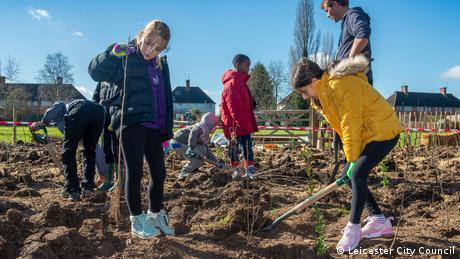 Children digging and planting in Leicester UK