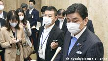 Japanese Defense Minister Nobuo Kishi (R) meets the press in Tokyo on May 18, 2021. Kishi said part of the online booking system will be fixed for reservations with large state-run vaccination centers in Tokyo and Osaka, following problems observed a day earlier -- the first day of taking reservations from elderly people. (Kyodo)