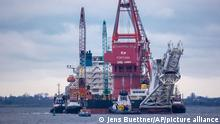 Jan. 14, 2021, ++++ file photo, tugboats get into position on the Russian pipe-laying vessel Fortuna in the port of Wismar, Germany. The special vessel is being used for construction work on the German-Russian Nord Stream 2 gas pipeline in the Baltic Sea. Pressure is growing on President Joe Biden to take action to prevent the completion of a Russian gas pipeline to Europe that many fear will give the Kremlin significant leverage over U.S. partners and allies. (Jens Buettner/dpa via AP)