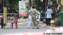 Medical workers arrive to test occupants of a hotel in a suspected virus hotspot street in Da Nang. This is not the first time the authorities have successfully cornered off a building or street in order to contain the virus and test people in its vicinity. DW, Hugh Bohane, 7.5.21