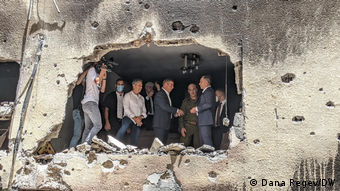 Germany's Foreign Minister Heiko Maas and Israel Foreign Minister Gabi Ashkenazi in May 2021 inspecting a rocket-hit house in Petah Tikvah, Israel.