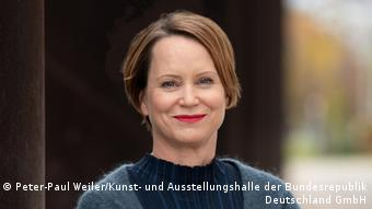 A photograph of Eva Kraus, director-general at the Art and Exhibition Hall of the Federal Republic of Germany in Bonn