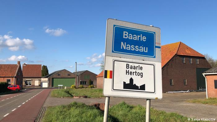 Town sign with the Belgian and Dutch names of Baarle