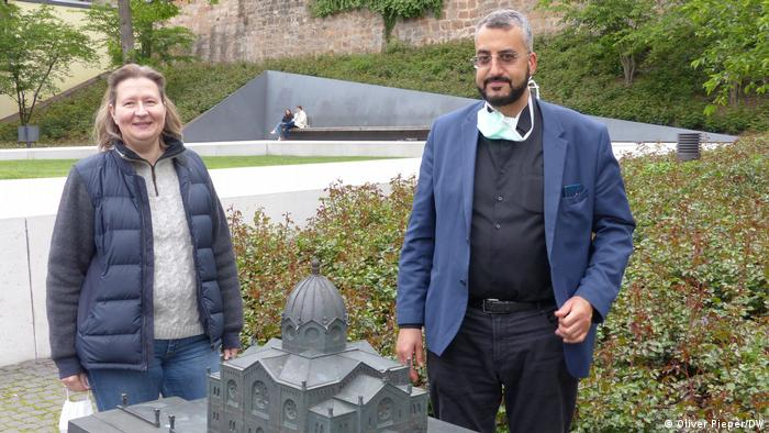 Petra Bunk and Bilal El-Zayat standing by a model of a Marburg synagogue which was destroyed in 1938