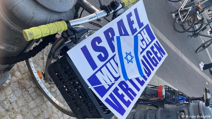 A placard reading, Israel must defend itself.