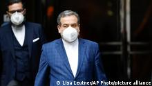 Political deputy at the Ministry of Foreign Affairs of Iran, Abbas Araghchi, leaves the 'Grand Hotel Wien' where closed-door nuclear talks take place in Vienna, Austria, Wednesday, May 19, 2021. World powers have held a fourth round of high-level talks aimed at bringing the United States back into a landmark nuclear deal with Iran. Both sides suggested a resolution was possible but major stumbling blocks remain. (AP Photo/Lisa Leutner)