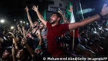 TOPSHOT - People take to the streets to celebrate following a ceasefire brokered by Egypt between Israel and the ruling Islamist movement Hamas in the Gaza Strip, in Gaza City early on May 21, 2021. - A ceasefire between Israel and Hamas, the Islamist movement which controls the Gaza Strip, came into force early on May 21, 2021 after 11 days of deadly fighting that pounded the Palestinian enclave and forced countless Israelis to seek shelter from rockets. (Photo by MOHAMMED ABED / AFP) (Photo by MOHAMMED ABED/AFP via Getty Images)