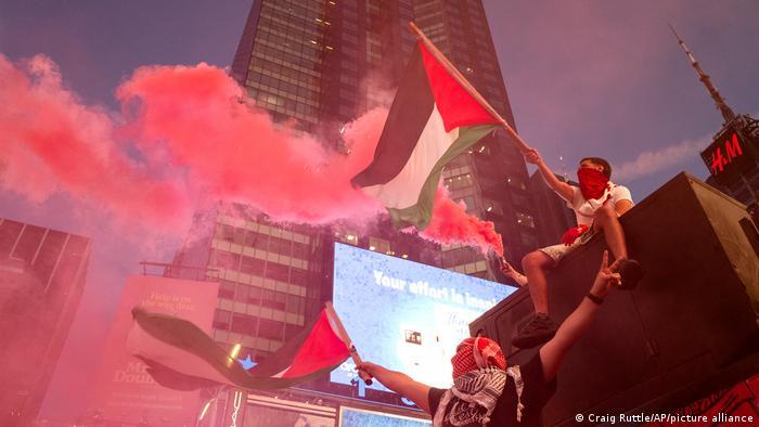 Palestinian supporters celebrate the truce in New York
