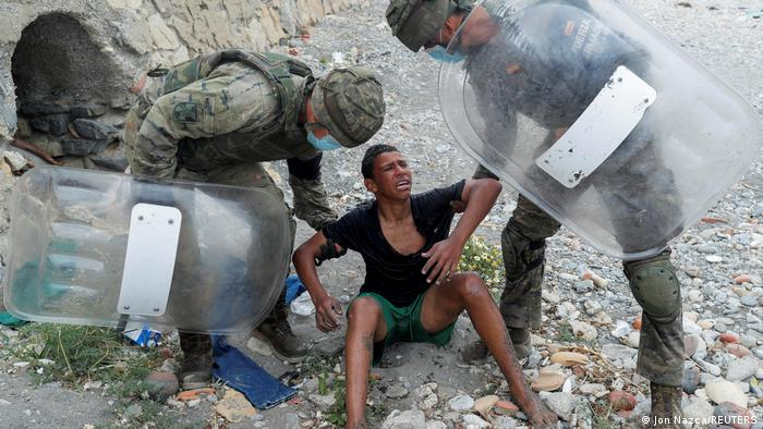 A Picture and its Story: I would rather die than go back, Moroccan migrant boy tells Spanish soldier