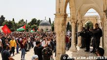 Israeli security stand in position as Palestinians protest at the compound that houses Al-Aqsa Mosque, known to Muslims as Noble Sanctuary and to Jews as Temple Mount, in Jerusalem's Old City May 21, 2021. REUTERS/Ammar Awad