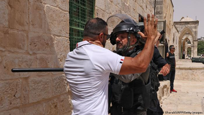 Israeli security force member with a protester