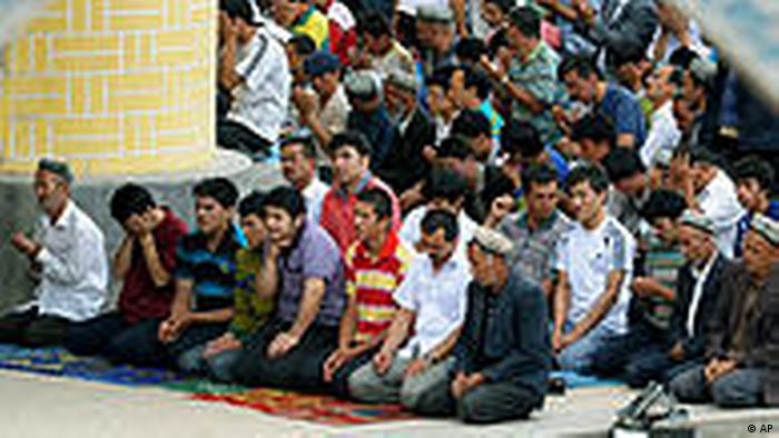 Uygurs offer Friday prayers at Id Kah Mosque in Kashgar in northwest China's Xinjiang Uygur Autonomous Region, Friday, July 2, 2010. Long-simmering tensions between Xinjiang's minority Uighurs and majority Han Chinese migrants turned into open violence in the streets of Urumqi, the capital of the traditionally Muslim region, last July. The government said 197 people were killed. (AP Photo/Kyodo News) ** JAPAN OUT, MANDATORY CREDIT, FOR COMMERCIAL USE ONLY IN NORTH AMERICA **
