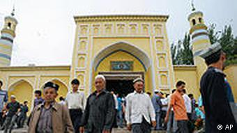 Uygurs leave Id Kah Mosque after offering Friday prayers in Kashgar in northwest China's Xinjiang Uygur Autonomous Region, Friday, July 2, 2010. Long-simmering tensions between Xinjiang's minority Uighurs and majority Han Chinese migrants turned into open violence in the streets of Urumqi, the capital of the traditionally Muslim region, last July. The government said 197 people were killed. (AP Photo/Kyodo News) ** JAPAN OUT, MANDATORY CREDIT, FOR COMMERCIAL USE ONLY IN NORTH AMERICA **