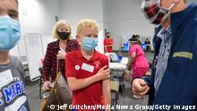 Santa Ana, CA - May 13: Jeremy Haworth, 12, holds on to his arm after getting his first COVID-19 vaccine at the Providence Edwards Lifesciences vaccination site, in Santa Ana, CA, on Thursday, May 13, 2021. (Photo by Jeff Gritchen/MediaNews Group/Orange County Register via Getty Images)